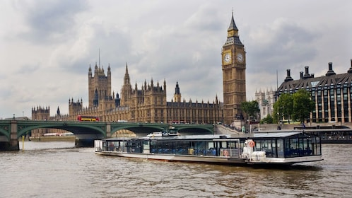 dining river barge sails past Big Ben and Parliament in London