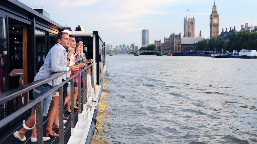 Show item 7 of 7. passengers enjoy sights of Parliament Building from river boat in London