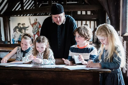 Shakespeare's Schoolroom & Guildhall_School Master and childrean at Georgian desk 2 _landscape_Sara Beaumont photography.jpg