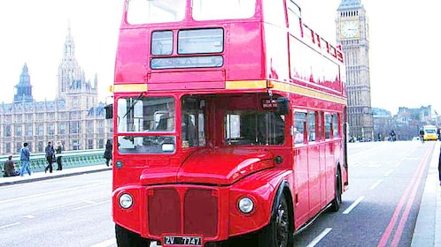 red double decker bus on streets of Westminster Abbey in London