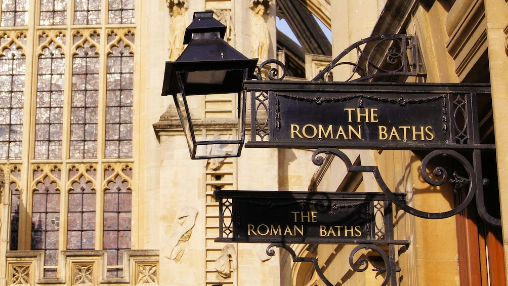 Show item 2 of 10. lamp post signs for The Bath House in London