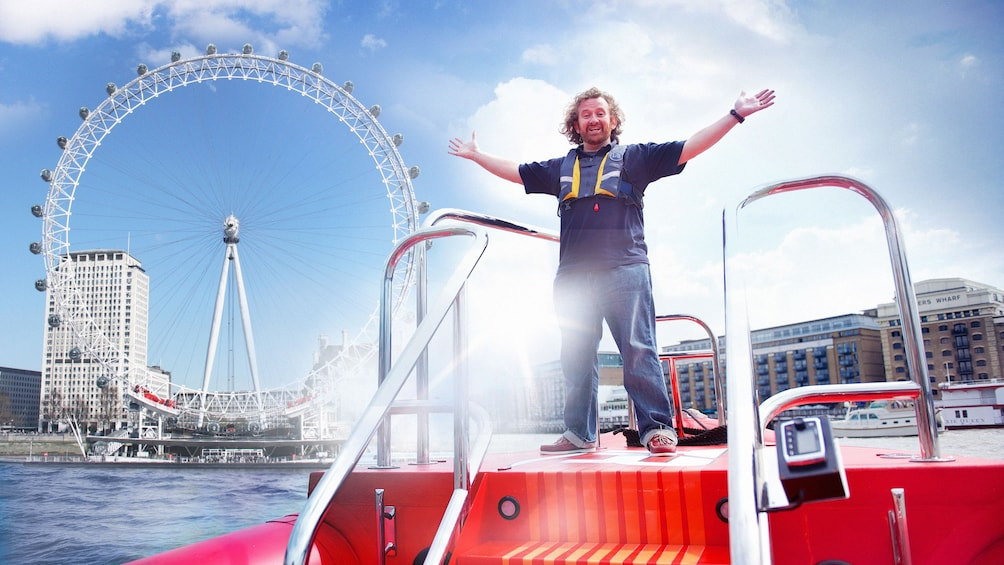Åpne bilde 3 av 5. man stands on deck of speedboat in London harbor