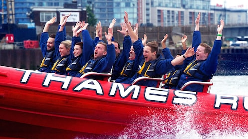 12 passengers raise their hands during speedboat ride in London
