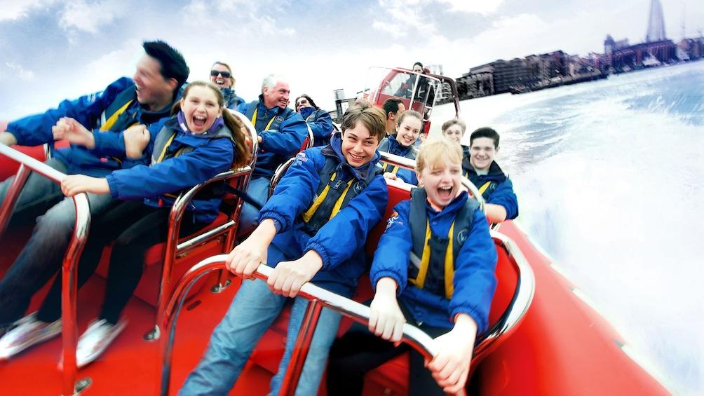 Åpne bilde 2 av 5. passengers hang on tight during speedboat ride in London