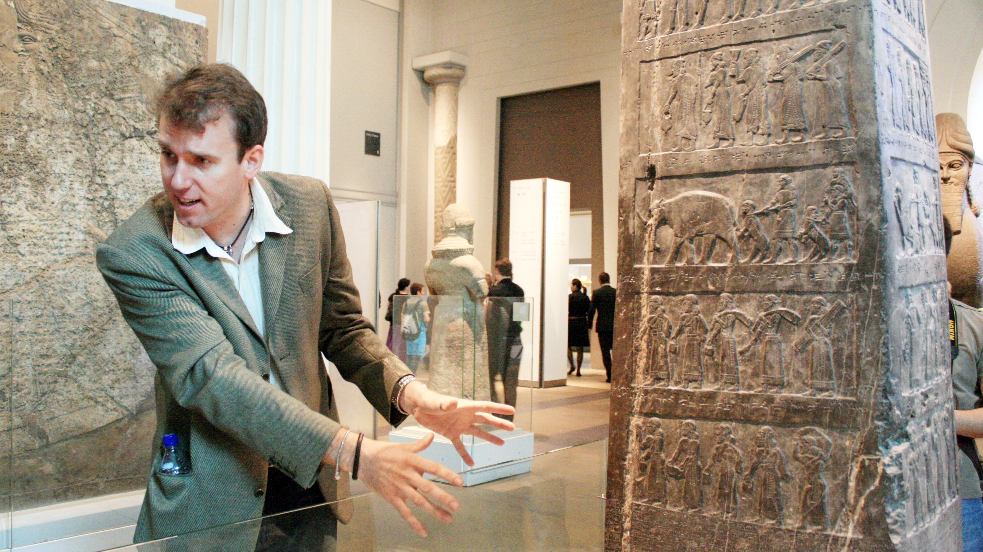 tour guide describing hieroglyphs in museum in London