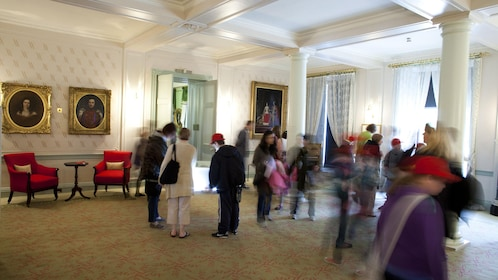 Visitors walking around room of Kensington Palace in London