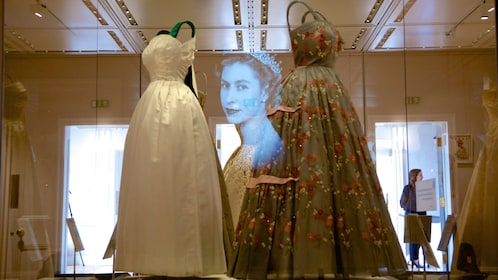 dresses on exhibition behind display case in Kensington Palace in London