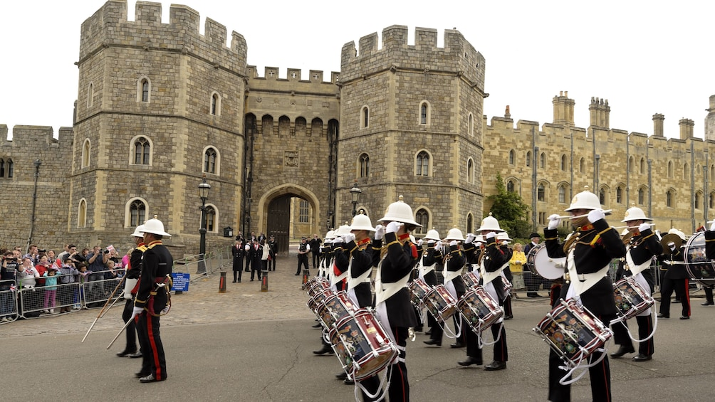 Show item 3 of 10. marching band playing drums at Windsor Castle in London