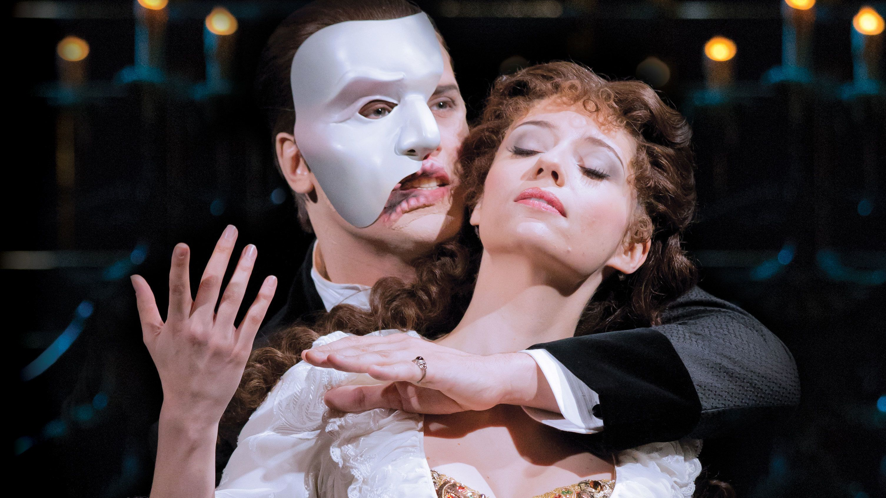 male and female actors sing together in Phantom of the Opera in London