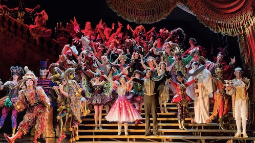 the cast of Phantom of the Opera bow before the audience on stage in London