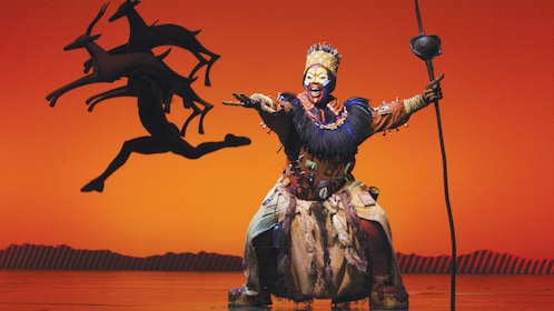 actors dancing in Theatre stage play of Lion King in London