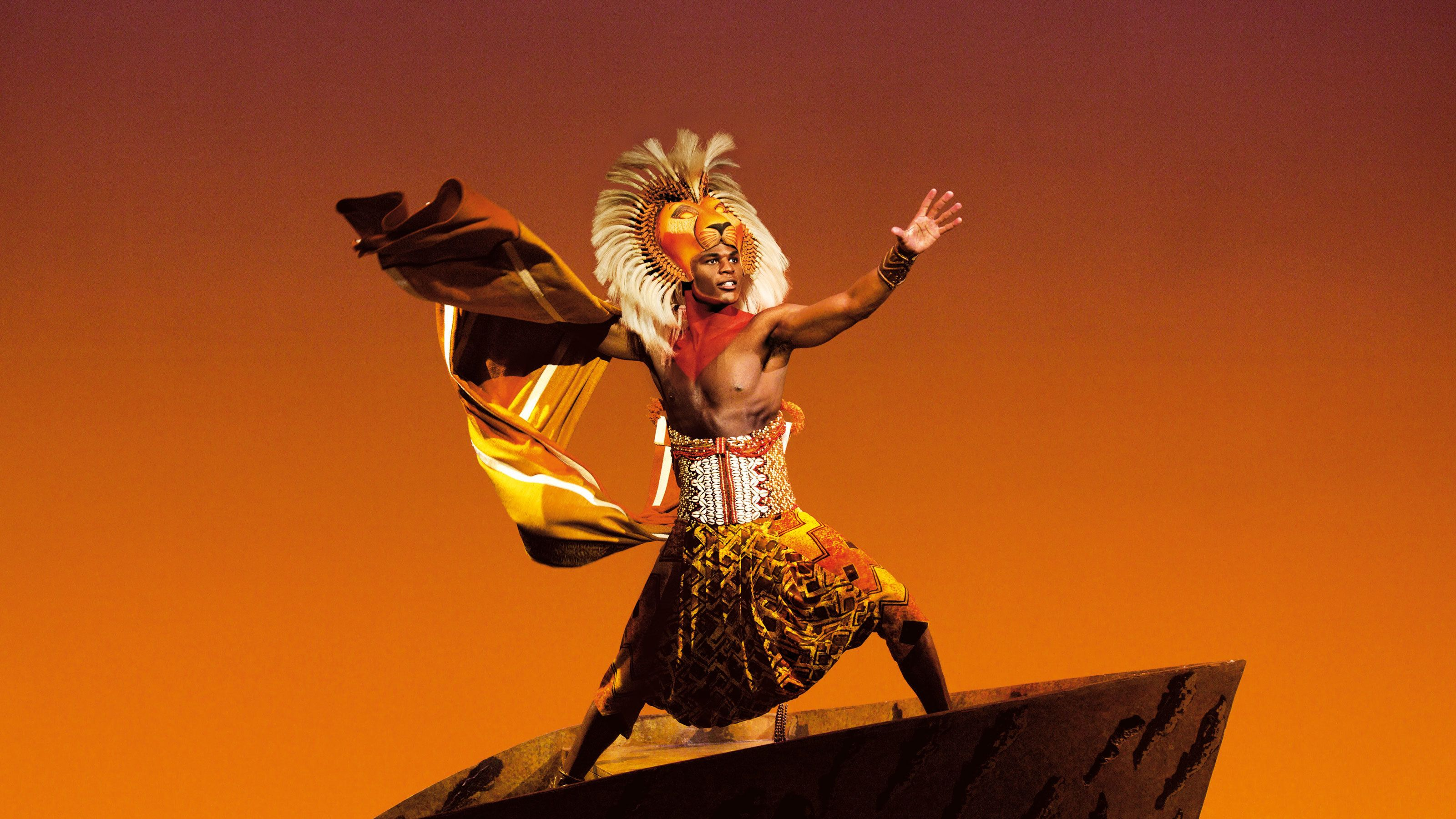 Actor plays the part of Lion in theatre stage play of Lion King in London
