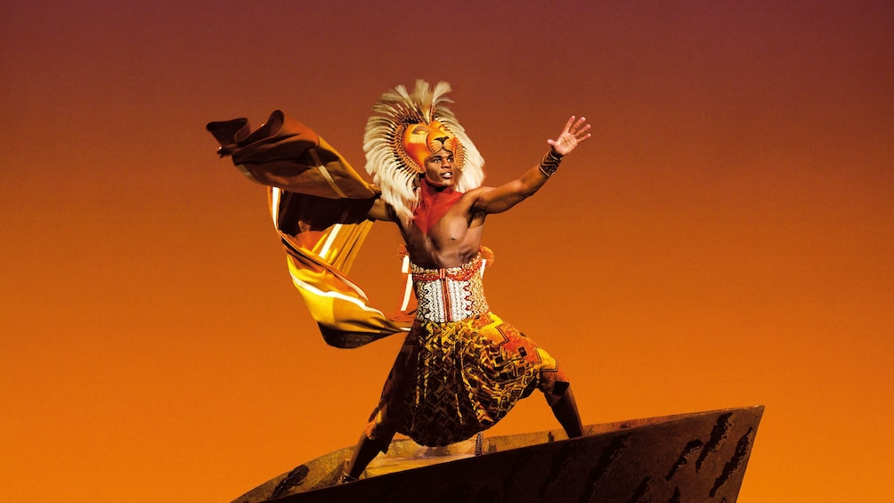 Show item 2 of 9. Actor plays the part of Lion in theatre stage play of Lion King in London