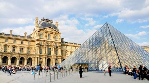 tourist farther around the Louvre in Paris