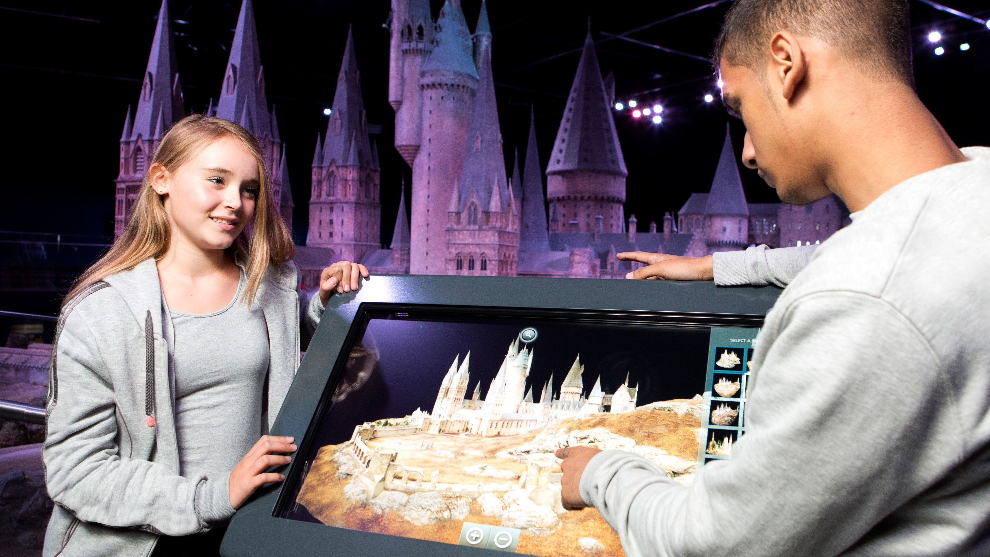 boy and girl look at interactive screen for on Harry Potter Tour in London