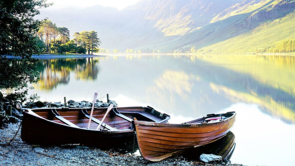 Show item 1 of 10. two canoes on shore by at Lake District in London
