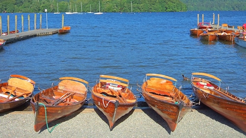 canoes docked on shore by lake in London