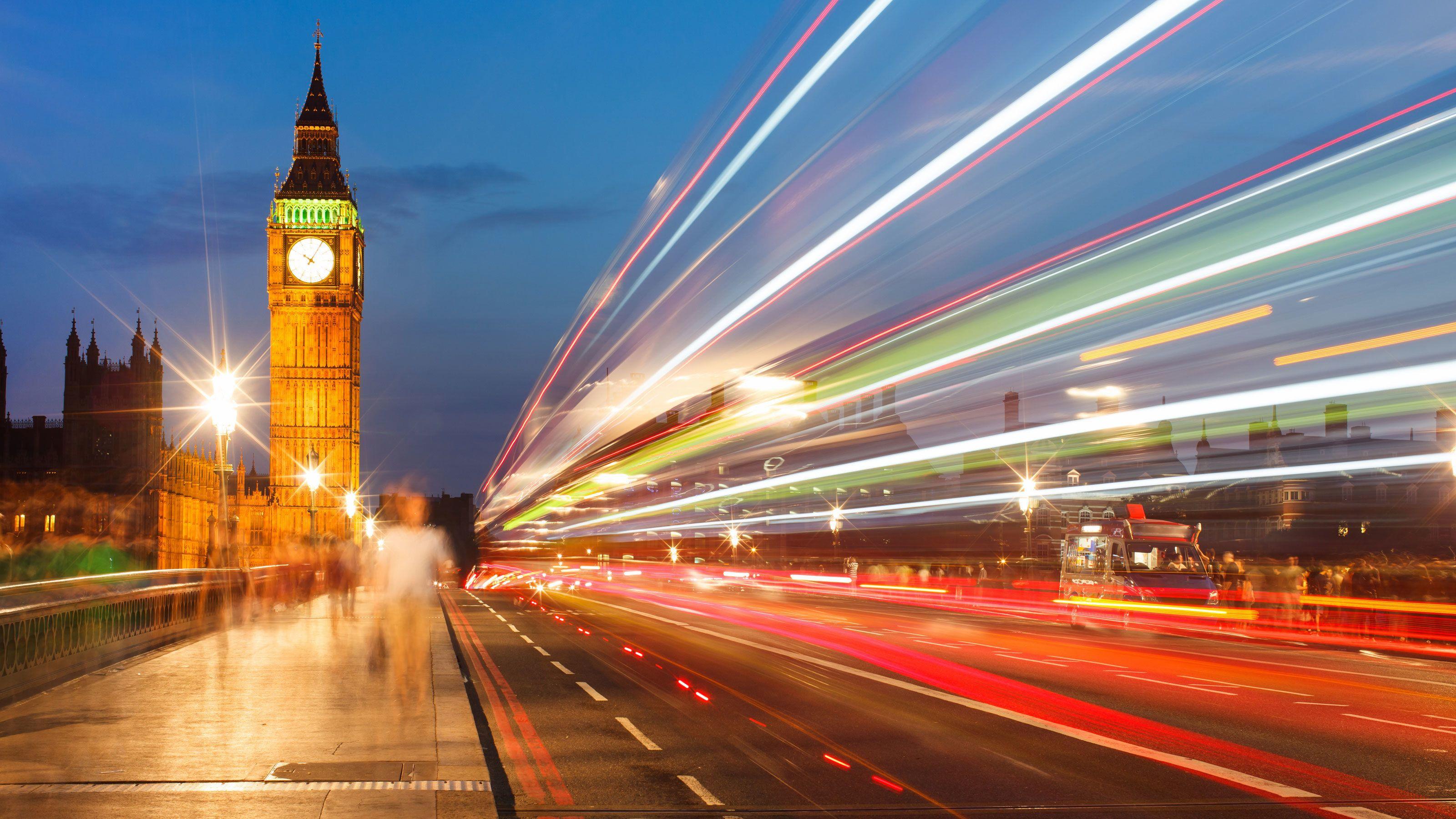 street traffic light streaks and Big Ben clock tower in London