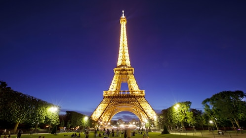 The Eiffel tower lit up at night in Paris