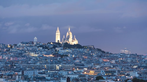 Montmartre on hill top at night in Paris