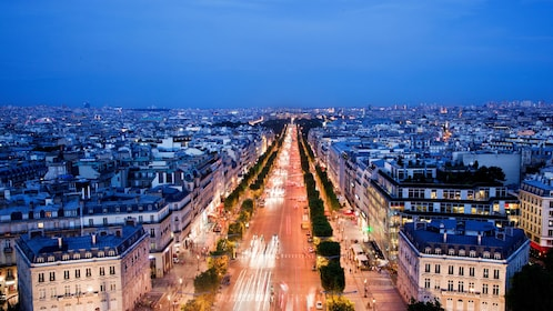 Paris streets and city buildings at night