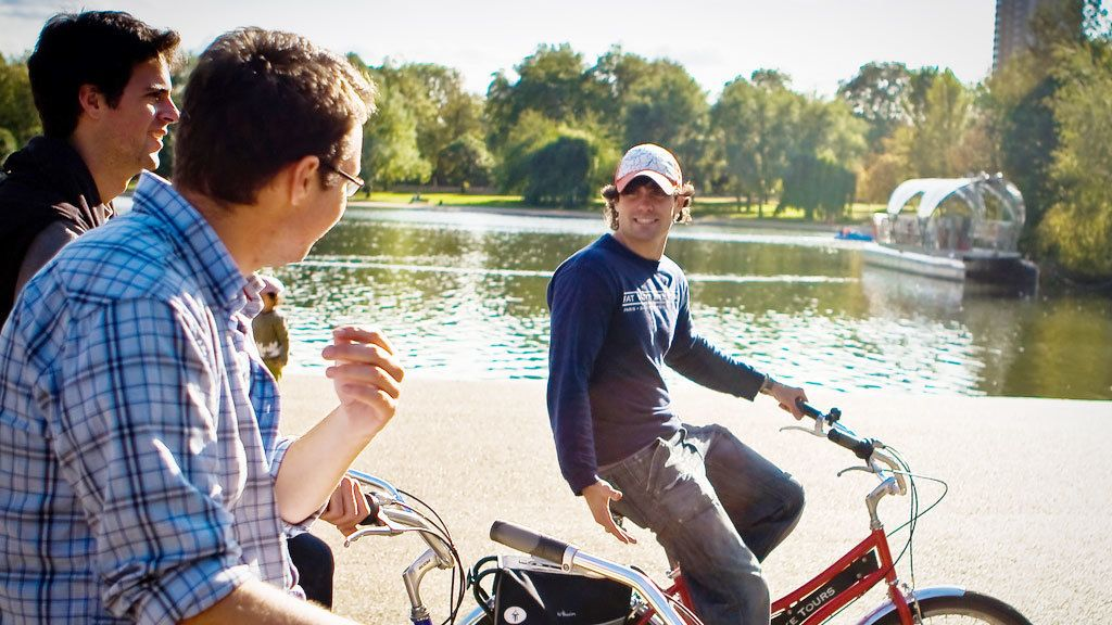 three men touring London on bicycles