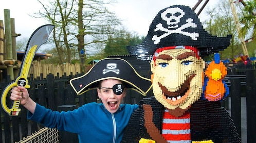 young boy poses next to Lego Pirate at Lego Land in London