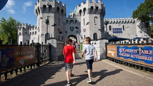 two boys walk toward entrance to lego castle at Lego Land in London