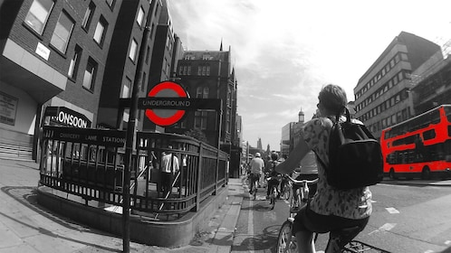 group of people riding cruiser bicycles through city streets in London