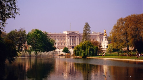 view of lake in front of Buckingham Palace in London