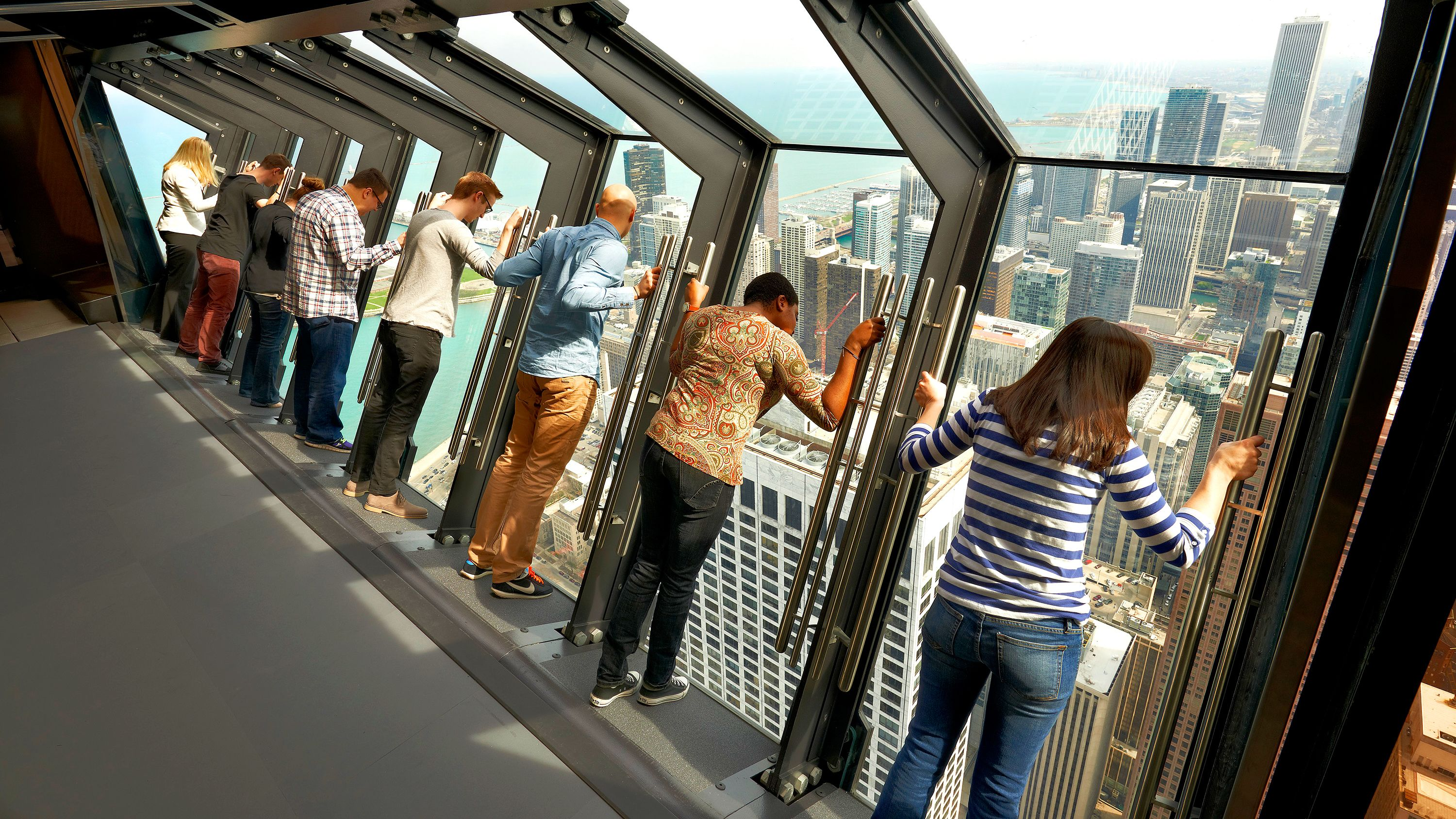 8 people at the titled view in Willis Tower, Chicago