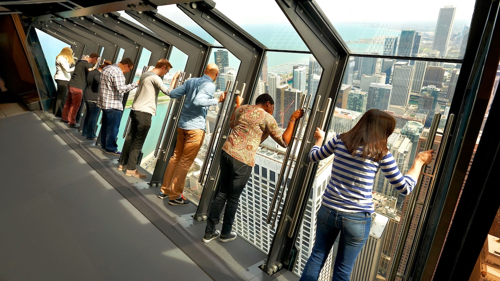 Show item 10 of 10. 8 people at the titled view in Willis Tower, Chicago