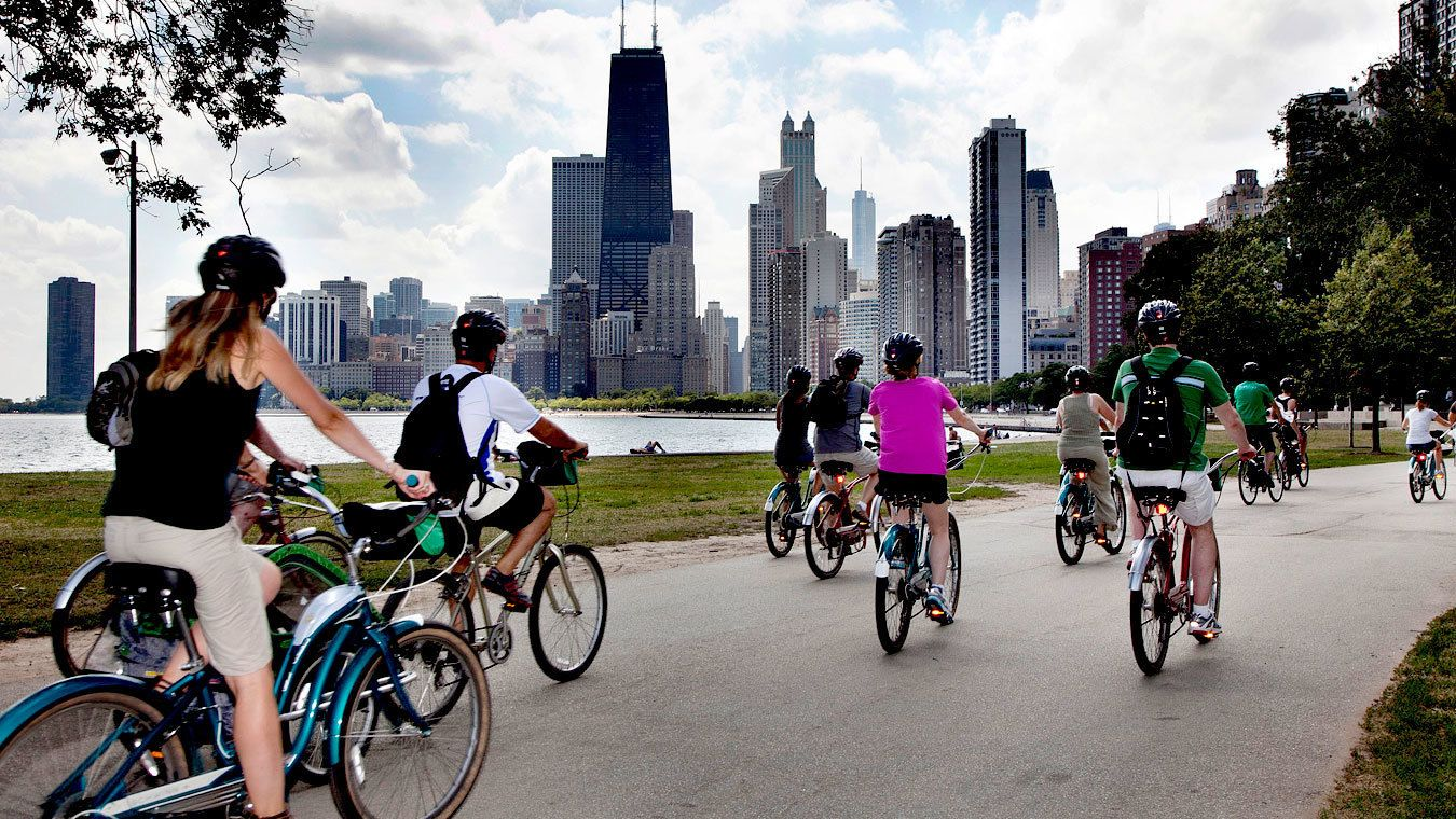 ten people on bicycles near the lake in chicago