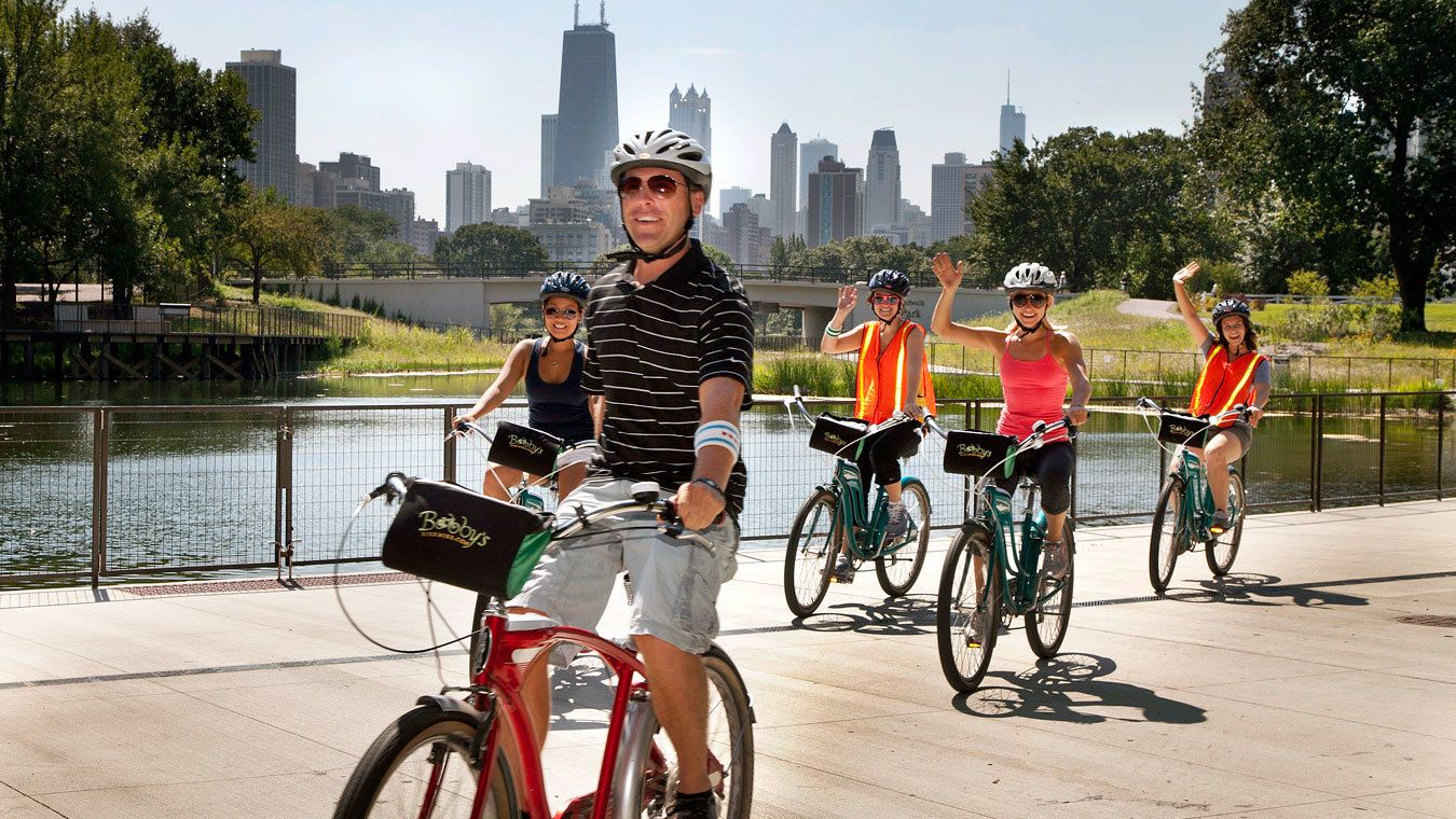 five people on bicycles in chicago
