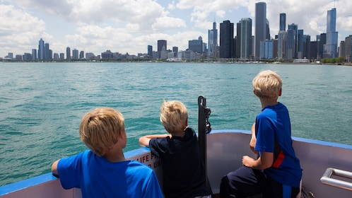 Kids on a boat looking at Chicago skyline
