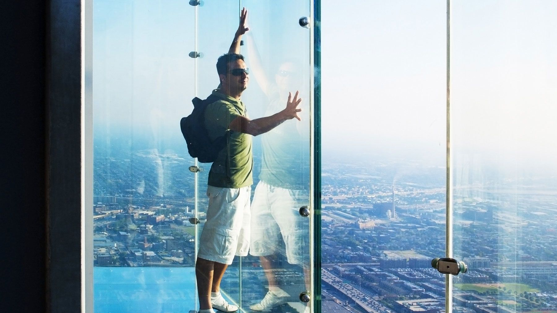Man touching window at the sky deck in chicago
