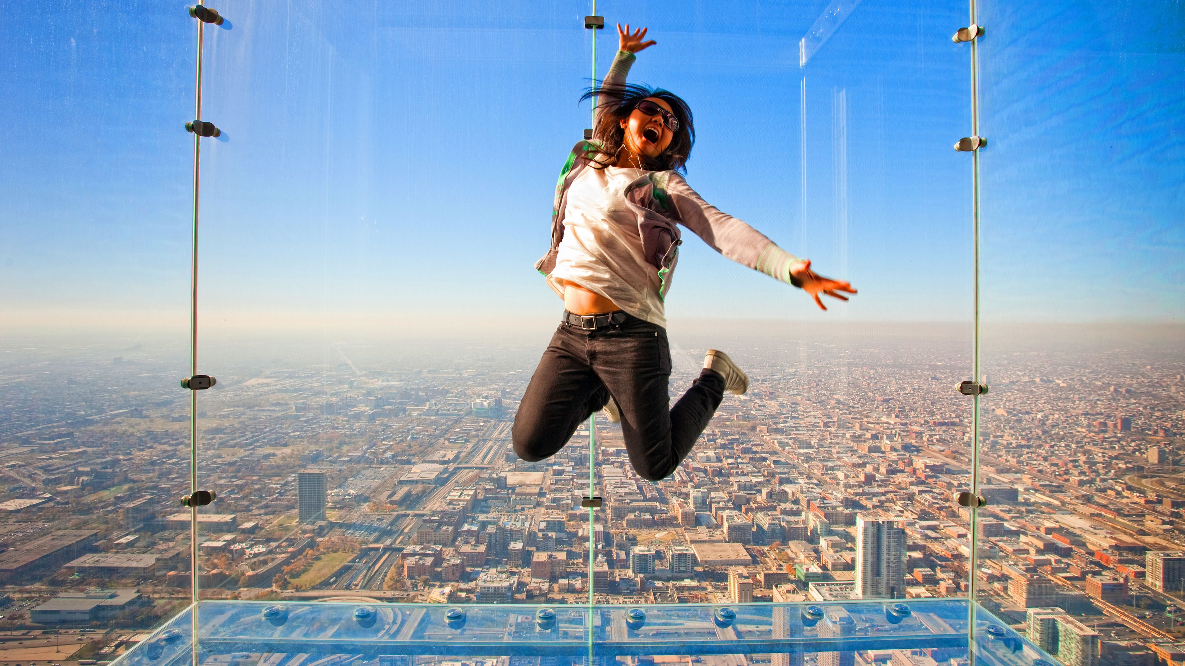 Woman jumping in Willis Tower observation deck