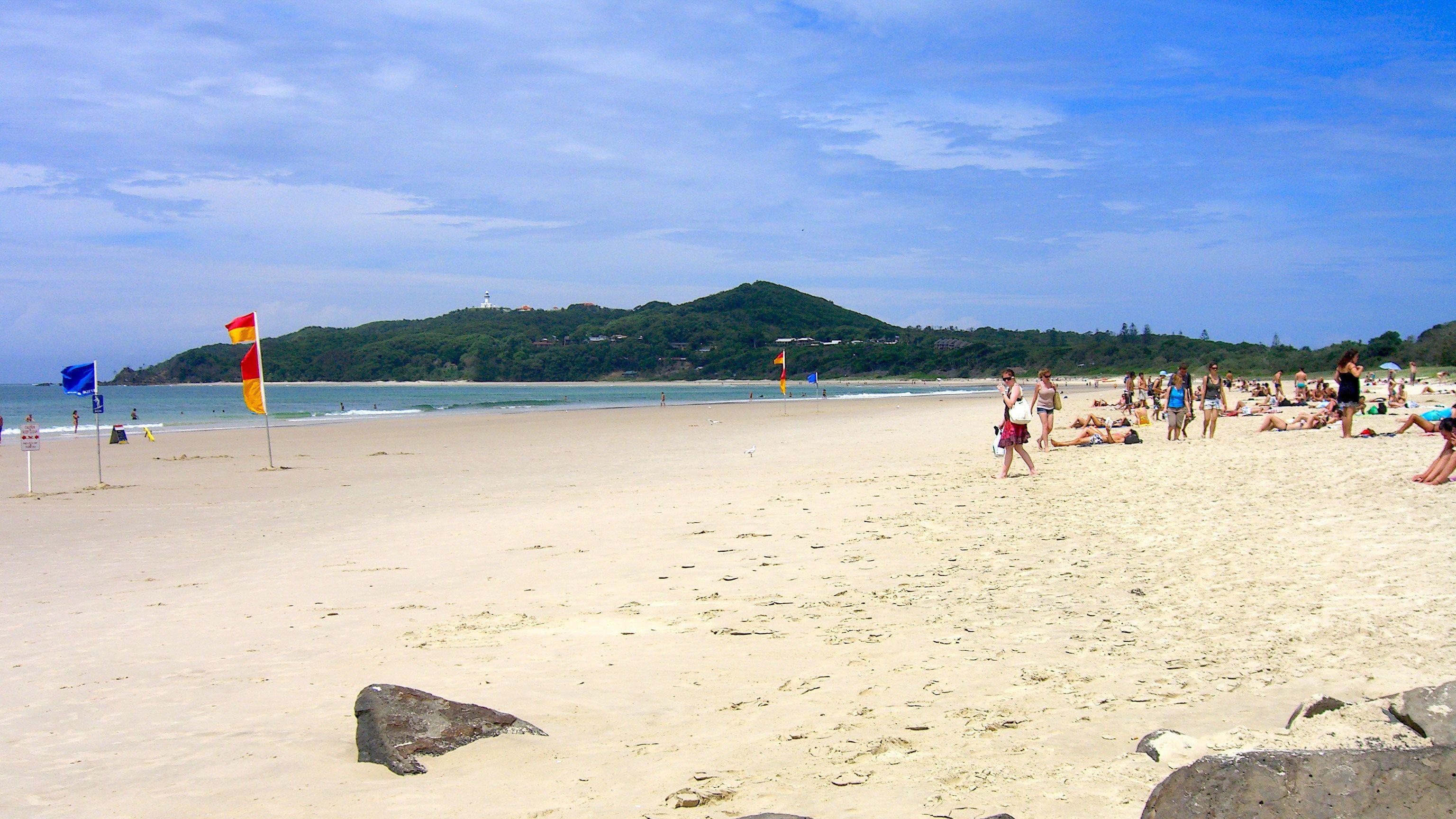 beachgoers enjoy the sun at Byron Bay in Australia