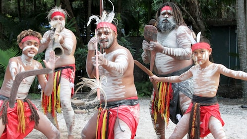People dressed in native clothing at Currumbin Wildlife Sanctuary in Gold Coast