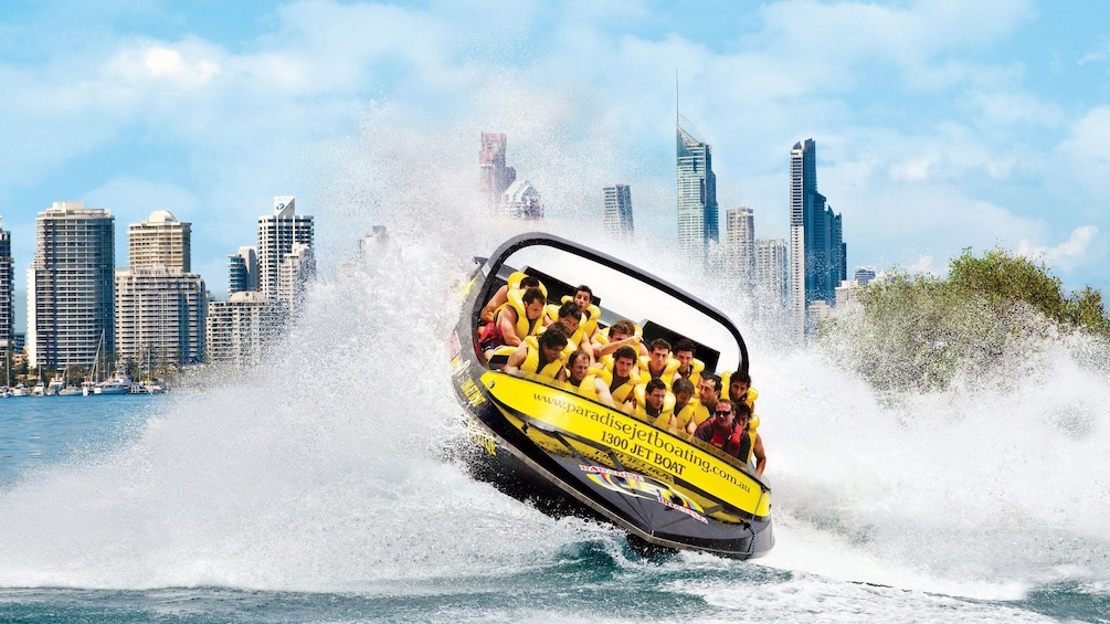 Show item 3 of 5. thrilled riders on a jet boat in Australia