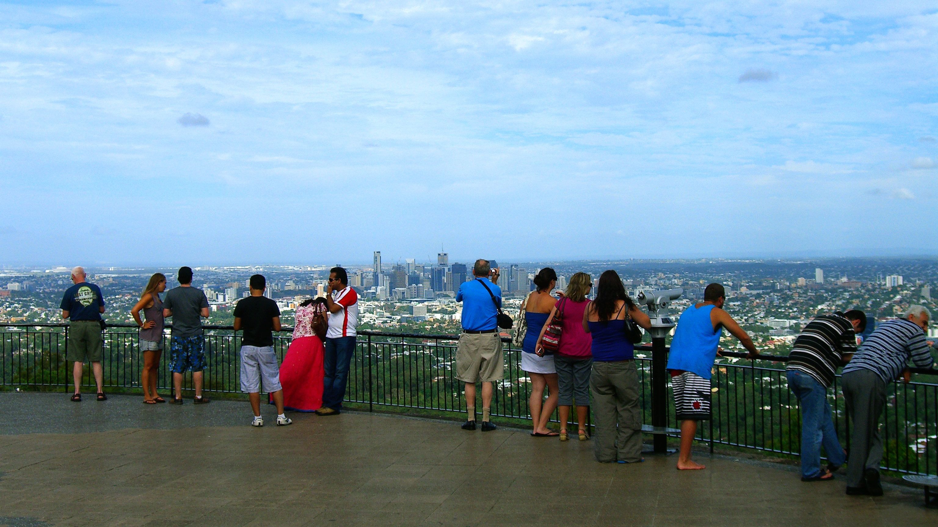 Tourist looking at the panoramic view of Brisbane from a view point