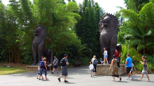 Guests walking by two statues at the Australia Zoo in Australia