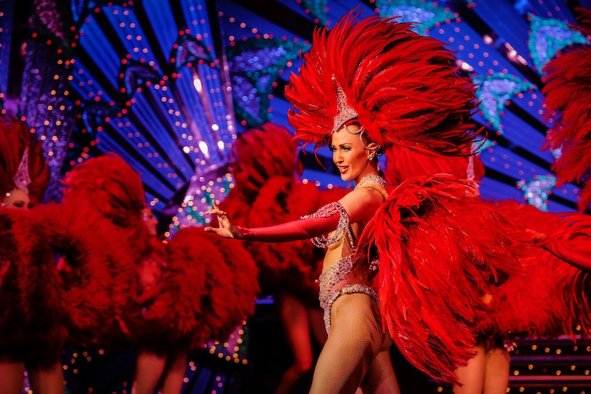 Show item 3 of 9. Can can dancers at the Moulin Rouge.