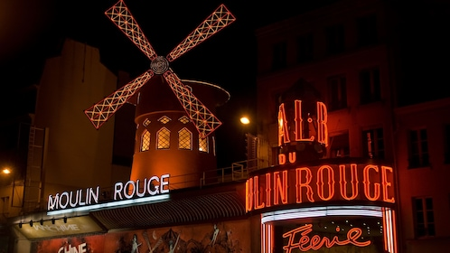 Moulin Rouge at night in Paris.