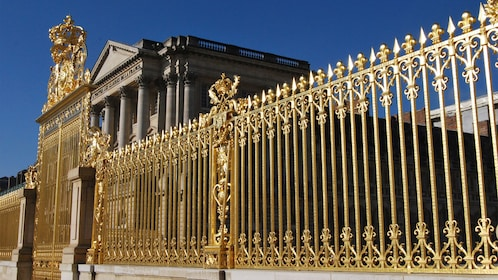 Golden gate outside a historical building in Paris.