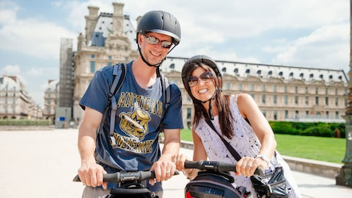 Couple on segways outside the Louvre in Paris