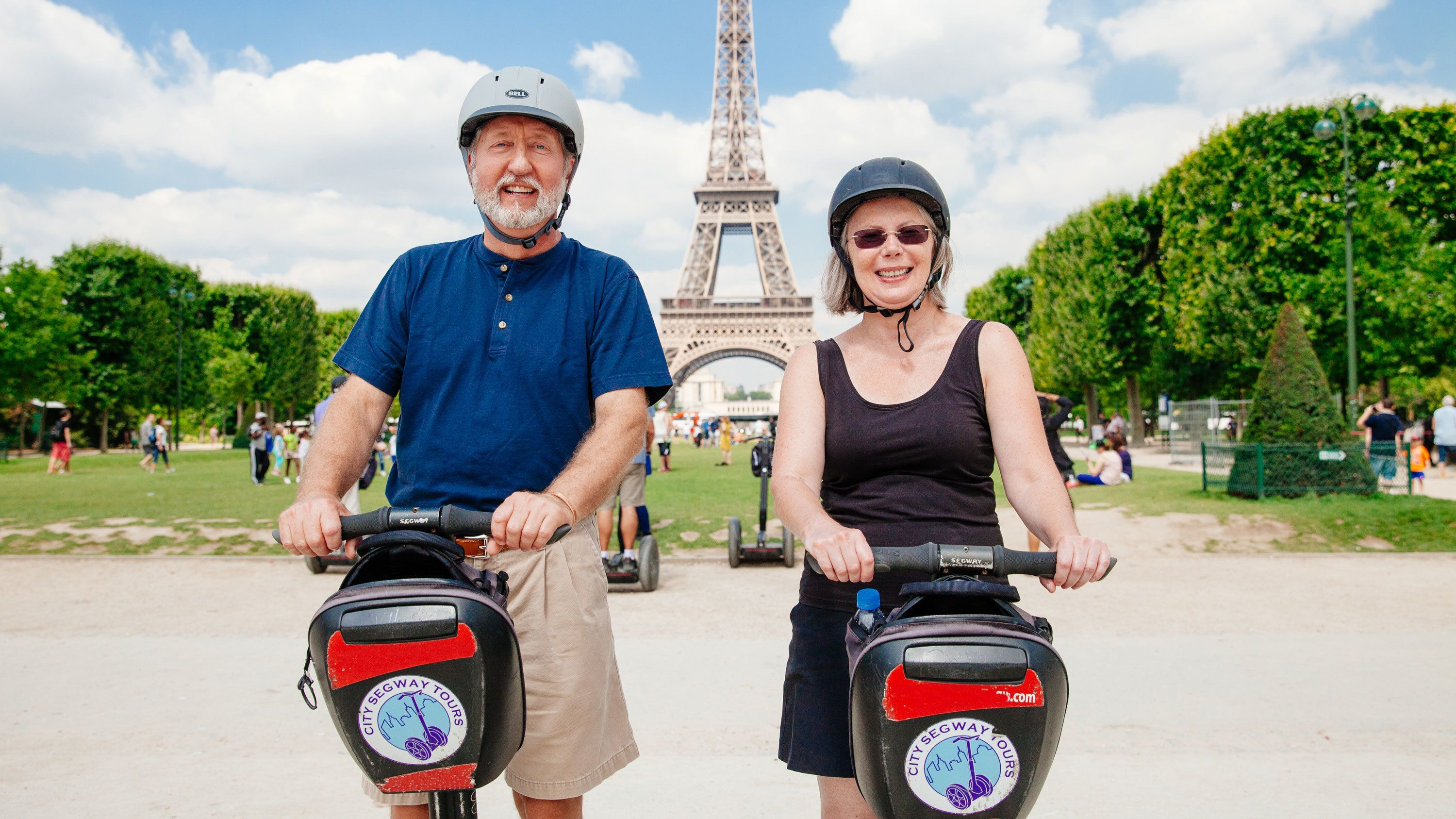 Two segway riders infront of the Eiffel tower