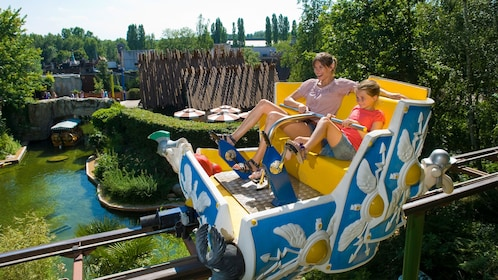Mother and daughter on a peddle ride at Parc Asterix in Paris.