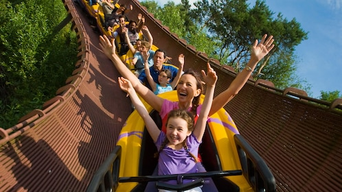 Families on a roller coaster in Parc Asterix in Paris.