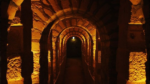 Arched halls in the catacombs of Paris.